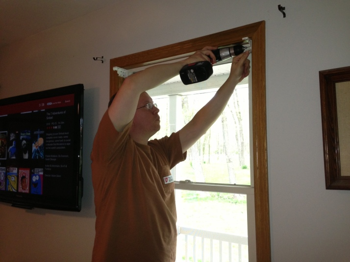 My husband putting up blinds.
