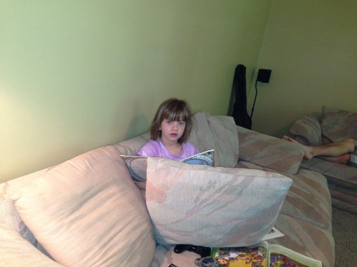 A buried herself in cushions to read because she was freezing cold.