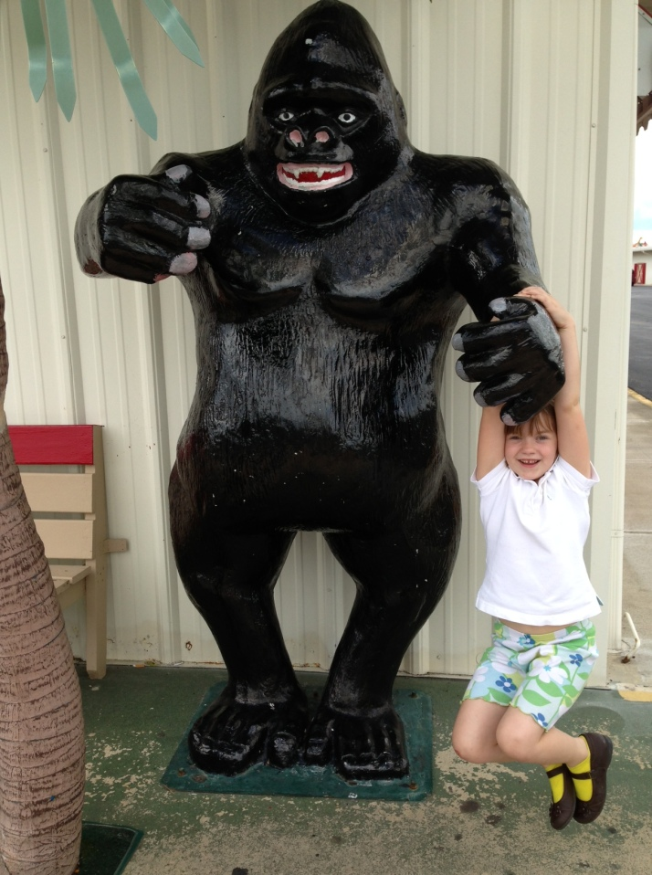A hanging on a gorilla statue.