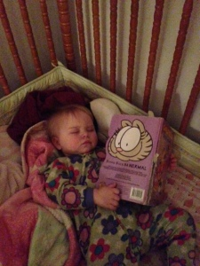 L reading herself to sleep