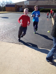 S racing to the finish after a 1 mile fun run