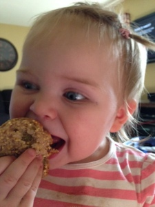 L eating a muffin.